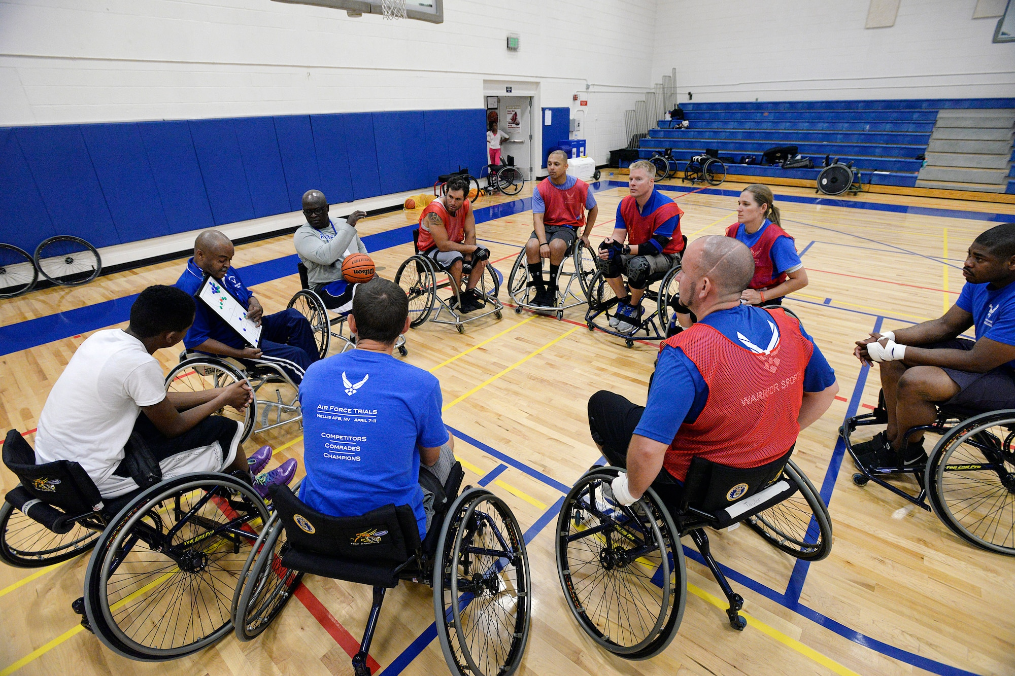 Wounded warriors gather around to learn a play during the final Warrior Games training camp at the Academy Aug. 5, 2014. More than 60 wounded veterans from across the country participated in the final Warrior and Invictus Games training camp here Aug. 3-7 to prepare for the fall games, motivate others and take a healthy step toward recovery. (U.S. Air Force photo/Mike Kaplan)