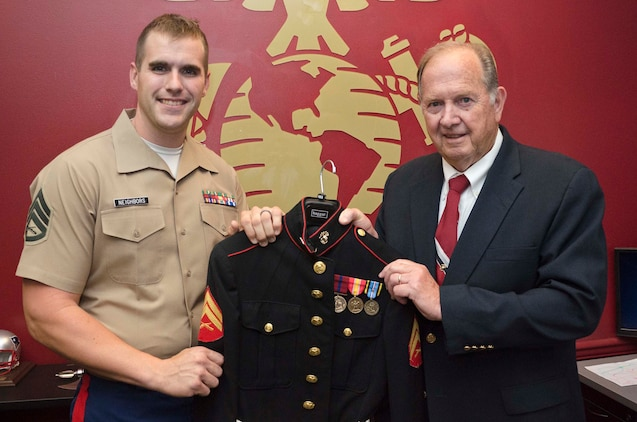 U.S. Marine Corps Staff Sgt. Max G. Neighbors, a canvassing recruiter with Recruiting Station Baltimore, poses with Robert L. Thomas and his dress blues jacket at Recruiting Sub-Station Salisbury, Md., July 21, 2014. The recruiters at RSS Salisbury were able to help Thomas arrange the medals correctly on his dress blues jacket. Thomas, a 73-year-old native of Cambridge, Md., served in the Marine Corps from 1959-63. (U.S. Marine Corps photo by Sgt Bryan J. Nygaard/Released)