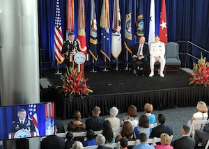 Lt. Gen. Michael Flynn speaks to family, friends and colleagues during his retirement ceremony at DIA Headquarters Aug. 7. Joining him on stage were Director of National Intelligence James Clapper and Director of the National Security Agency Adm. Michael Rogers.