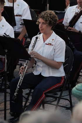 On June 5, 2014, Col. Michael J. Colburn conducted his last Marine Band concert as Director on the West Terrace of the U.S. Capitol in Washington, D.C. Pictured is oboe/English horn player Staff Sgt. Tessa Vinson. (U.S. Marine Corps photo by Master Sgt. Kristin duBois/released)