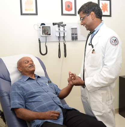 Dr. Udayakumar Kathaiyan, a primary care provider, (left) talks with Army veteran Walter Crawford Aug. 1 at the Veterans Administration community-based outpatient clinic now located aboard Marine Corps Logistics Base Albany.