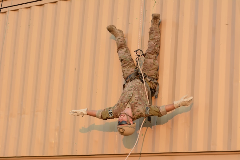 Senior Airman Nash Bauer, 115th Fighter Wing explosive ordnance disposal flight, hangs upside down while rappelling during the 2014 PATRIOT exercise at Volk Field Air National Guard Base, Wis., July 20, 2014. The EOD Airmen in attendance to the exercise learned how to tie proper knots for rappelling, participated in fast rope exercises, climbed a free-falling ladder, assembled and disassembled various bomb types, and received all-terrain vehicle training certification during their stay. (Air National Guard photo by Senior Airman Andrea F. Liechti)