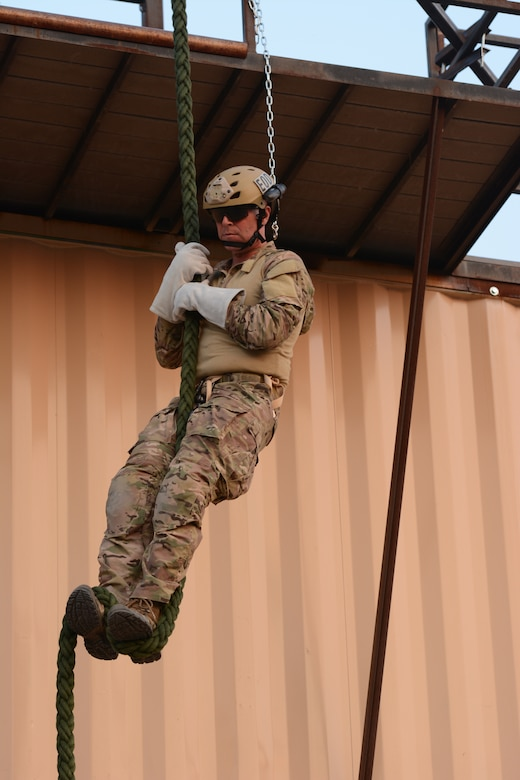 Master Sgt. Jeffery K. Martin, 155th Air Refueling Wing explosive ordnance disposal flight superintendent, slides down the fast rope during the 2014 PATRIOT exercise at Volk Field Air National Guard Base, Wis., July 20, 2014. He was an instructor for the younger EOD Airmen during the various exercises. (Air National Guard photo by Senior Airman Andrea F. Liechti)