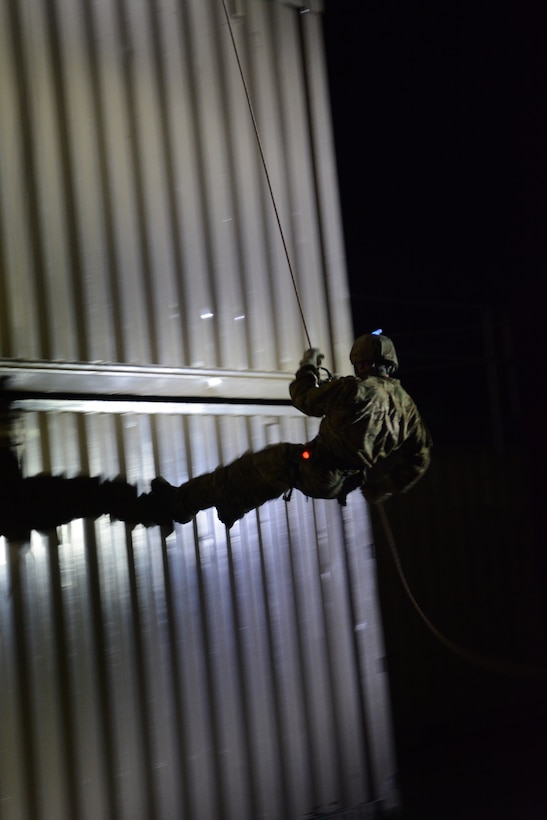 Airmen from the 115th Fighter Wing, 104th Fighter Wing and 155th Air Refueling Wing completed various rappelling activities during the 2014 PATRIOT exercise at Volk Field Air National Guard Base, Wis., July 20, 2014. The three units used the exercise to learn as much from each other as possible. The EOD Airmen learned how to tie proper knots for rappelling, participated in fast rope exercises, climbed a free-falling ladder, assembled and disassembled various bomb types, and received all-terrain vehicle training certification during their stay. (Air National Guard photo by Senior Airman Andrea F. Liechti)