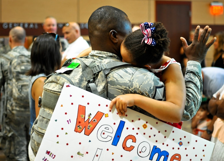 U.S. Air Force Master Sgt. Christopher R. Jones, specialist with the 182nd Security Forces Squadron, reunites with family and friends after arriving home at the General Wayne A. Downing Peoria International Airport in Peoria, Ill., Aug. 6, 2014. He and 17 Illinois Air National Guardsmen deployed to Southwest Asia for seven months in support of Operation Enduring Freedom. They were assigned to the 405th Expeditionary Security Forces Squadron overseas, where they were responsible for law enforcement and security missions in the region's global war on terror. (U.S. Air National Guard photo by Staff Sgt. Lealan Buehrer/Released)