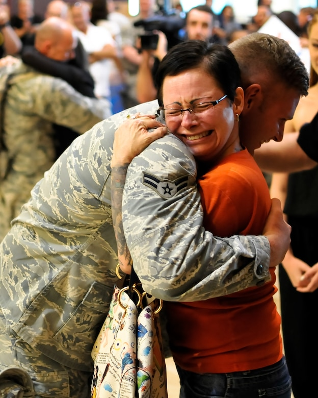 U.S. Air Force Senior Airman Jordan A.D. Sanford, security forces journeyman with the 182nd Security Forces Squadron, reunites with family and friends after arriving home at the General Wayne A. Downing Peoria International Airport in Peoria, Ill., Aug. 6, 2014. He and 17 Illinois Air National Guardsmen deployed to Southwest Asia for seven months in support of Operation Enduring Freedom. They were assigned to the 405th Expeditionary Security Forces Squadron overseas, where they were responsible for law enforcement and security missions in the region's global war on terror. (U.S. Air National Guard photo by Staff Sgt. Lealan Buehrer/Released)