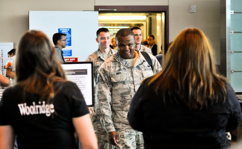 U.S. Air Force Master Sgt. Christopher R. Jones, squad leader with the 182nd Security Forces Squadron, leads the way as his Airmen arrive home at the General Wayne A. Downing Peoria International Airport in Peoria, Ill., Aug. 6, 2014. He and 17 Illinois Air National Guardsmen deployed to Southwest Asia for seven months in support of Operation Enduring Freedom. They were assigned to the 405th Expeditionary Security Forces Squadron overseas, where they were responsible for law enforcement and security missions in the region's global war on terror. (U.S. Air National Guard photo by Staff Sgt. Lealan Buehrer/Released)