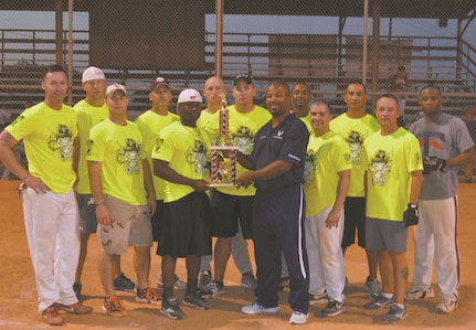 Joint Base San Antonio-Lackland Fitness and Sports Director Dwayne Reed presents the 737th Training Group with the JBSA-Lackland Intramural Softball trophy Aug. 6, 2014 at Warhawk Field  (Photo by Jose T. Garza III).