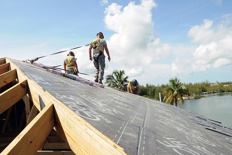 Airmen of the 143d Airlift Wing Civil Engineering Squadron, build a new roof for the women's barracks and latrine for the Royal Bahamas Defence Force (RBDF) at the Coral Harbour Base in Nassau, Bahamas on June 23, 2014 for their inaugural group DFT (Deployment For Training) to support the RBDF in conjunction with the National Guard State Partnership Program (SPP). National Guard Photo by Master Sgt John McDonald (RELEASED)