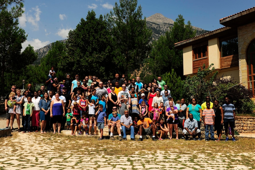 Family retreat attendees take a group photo July 27, 2014, Pozanti, Turkey. The families spent the weekend in the mountains of Pozanti and attended learning sessions which included both parents and children. (U.S. Air Force photo by Staff Sgt. Eboni Reams/Released)