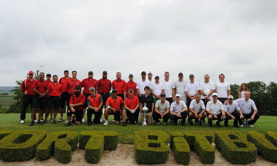 Participants from the Eifel Mountain Golf Course team and Bitburger Land Golf Course team pose for a photo Aug. 3, 2014, at Bitburger Land Golf Course in Bitburg, Germany. Several Sabers from Spangdahlem Air Base, Germany, took part in the Bitburgerland Ryder Cup tournament during the two-day tournament. (U.S. Air Force photo by Airman 1st Class Dylan Nuckolls/Released)
