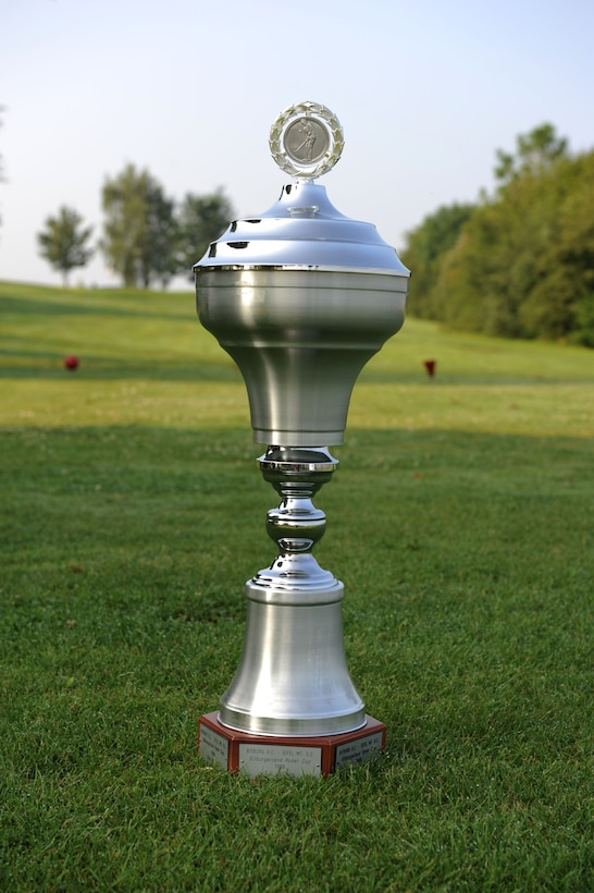 The Bitburgerland Ryder Cup tournament trophy sits on the first tee box July 27, 2014 at the Eifel Mountain Golf Course at Spangdahlem Air Base, Germany. Each team had 14 players compete to earn the needed 14.5 points to win the match. The Eifel Mountain Golf Course team from Spangdahlem Air Base, Germany, won this year's tournament with 17 points. (U.S. Air Force photo by Airman 1st Class Dylan Nuckolls/Released)