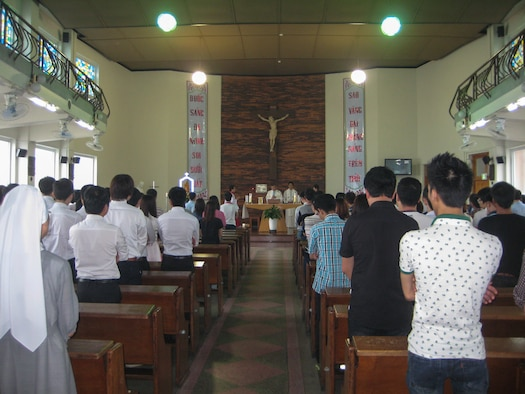 Chaplain (Capt.) Thienan Tran, 51st Fighter Wing chaplain, leads church members in prayer during a Catholic Mass at Cho-Rang Catholic Church in Busan, Republic of Korea, Aug. 3, 2014. Tran, a Catholic priest, spends his off-duty time providing Catholic Mass to communities of Vietnamese labor workers. (Courtesy photo)