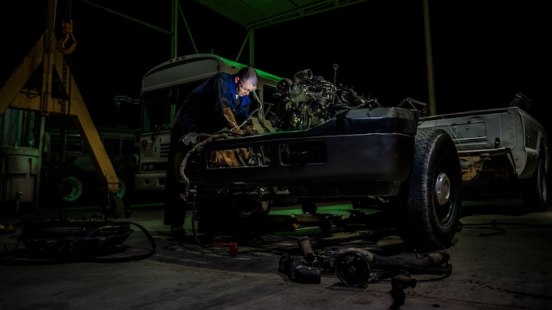 Senior Airman Christopher Moore removes the engine of a truck July 18, 2014, at an undisclosed location in Southwest Asia. Moore, a vehicle mechanic with the 386th Expeditionary Logistics Readiness Squadron, deployed from the 86th Vehicle Readiness Squadron, Ramstein Air Base, Germany in support of Operation Enduring Freedom. (U.S. Air Force photo/Staff Sgt. Jeremy Bowcock)