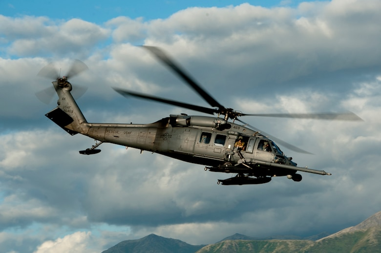 An HH-60 Pave Hawk flies over the Malemute drop zone during a pararescue training mission on Joint Base Elmendorf-Richardson, Alaska, July 30, 2014. The rescue squadron trains with many of the aircraft units on base to carry out routine training missions to stay proficient in their required skills. (U.S. Air Force photo/Airman 1st Class Tammie Ramsouer)