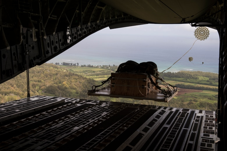 A C-17 Globemaster III airdrops a pallet over a Hawaiian drop zone on Aug. 1, 2014. The C-17, from the 535th Airlift Squadron, provides airlift and airdrop capabilities to the Pacific theater. The airdrop mission is part of the routine training for the aircrew and logistics personnel. (U.S. Air Force photo/Staff Sgt. Stephany Richards)