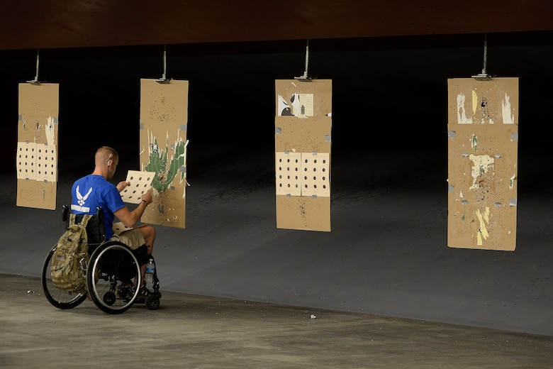 Jeremiah Means, Wounded Warrior athlete, checks his targets during competition shooting practice Aug. 3, 2014, at Fort Collins, Colo. The athletes are conducting their final group practices prior to the upcoming Invictus Games in London Sept. 10 through14 and the Warrior Games Sept. 28 through Oct. 4, 2014.  (U.S. Air Force photo\ Staff Sgt.Tim Chacon)