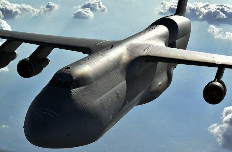A C-5 Galaxy flies behind a KC-135 Stratotanker from McConnell Air Force Base, Kan., during an air refueling training exercise, Aug. 5, 2014. The C-5 is assigned to the Air Force Reserve 433rd Airlift Wing, Joint Base San Antonio, Texas. The KC-135 was operated by an aircrew made up of reservists from the 931st Air Refueling Group at McConnell. The 931 ARG regularly supports air refueling training for new C-5 pilots who are attending training at the Formal Training Unit (FTU) at Joint Base San Antonio. (U.S. Air Force photo/Senior Master Sgt. Brad Beyer)