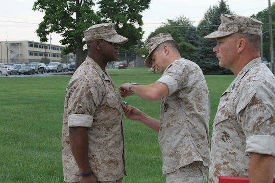 U.S. Marine Corps Master Sgt. Tommy Moye, a native of Quincy, Fla. and 1991 graduate of James A. Shanks High School, recieves the Navy and Marine Corps Commendation Medal Aug. 6, 2014.  Moye served as a 4th Marine Corps District training team member at the Defense Distribution Center Susquehanna in New Cumberland, Pa. As a training team member, he was responsible for monitoring and inspecting Recruiting Stations and Recruiting Sub-Stations across the district to ensure that systematic recruiting is a constant practice. Moye executed Permanent Change of Station orders to RS Raleigh and will now become the RI for RS Raleigh to ensure the recruiters of RS Raleigh recruit and enlist the most eligible for the U.S. Marine Corps. (U.S. Marine Corps photo by Cpl. Tyler Birky/Released)
