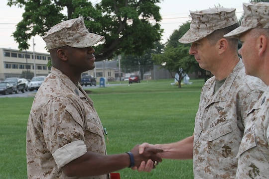 U.S. Marine Corps Master Sgt. Tommy Moye, a native of Quincy, Fla. and 1991 graduate of James A. Shanks High School, shakes the hand of U.S. Marine Corps Col John A. Bolt, the commanding officer of the 4th Marine Corps District, after receiving the Navy and Marine Corps Commendation Medal Aug. 6, 2014.  Moye served as a 4MCD training team member at the Defense Distribution Center Susquehanna in New Cumberland, Pa. As a training team member, he was responsible for monitoring and inspecting Recruiting Stations and Recruiting Sub-Stations across the district to ensure that systematic recruiting is a constant practice. Moye executed Permanent Change of Station orders to RS Raleigh and will now become the RI for RS Raleigh to ensure the recruiters of RS Raleigh recruit and enlist the most eligible for the U.S. Marine Corps. (U.S. Marine Corps photo by Cpl. Tyler Birky/Released)