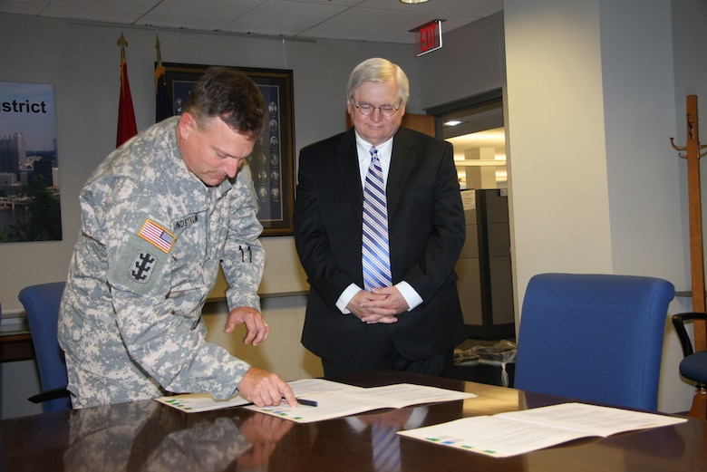 The simple act of putting pen to paper sealed the deal on a new partnership between two public agencies. While other districts have performed planning assistance for states in their regions, the agreement signed, Aug. 6, by Col. Bernard Lindstrom, Pittsburgh District commander, and James Hassinger, Southwestern Pennsylvania Commission executive director, is a first for the district.