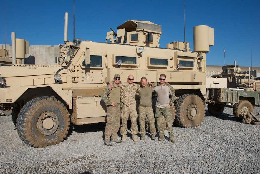 Tech. Sgt. Jeremy Miller, 509th Civil Engineer Squadron NCO in charge of EOD, third from the left, deployed to Southwest Asia from Sept. 1, 2013 to May 1, 2014. Miller deployed with a coalition force and joint force of U.S. Army, U.S. Air Force and Romanian Army Service members to train Afghan soldiers on various EOD techniques as part of a coalition interoperability training mission with the Afghan National Army. (U.S. Air Force photo by Tech. Sgt. Jeremy Miller/Released)