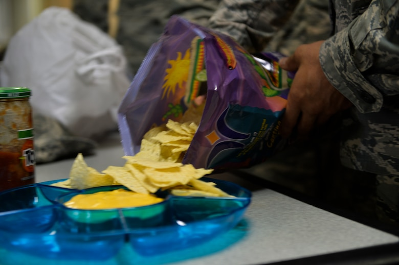 Tortilla chips are spread onto a plate for a diversity lunch at the Airman Leadership School house on Hurlburt Field, Fla., Aug. 5, 2014. The students are encouraged to bring a dish that represents their ethnic background. (U.S. Air Force photo/Senior Airman Christopher Callaway)