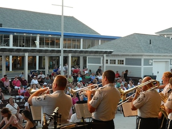 Members of High Altitude perform for an enthusiastic crowd at Hampton Beach, NH on June 30, 2014.  High Altitude was one of several different ensembles which performed on the Ocean front stage for hundreds of audience members.  (U.S. Air Force Photo/Technical Sgt. Dawn Hoffman)
