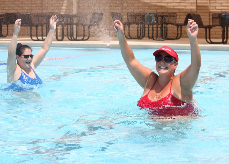 Valeria Bowman, right, 56th Force Support Squadron Silver Wings Pool manager and water aerobics instructor, leads a water aerobics class July 31 in the Silver Wings Pool on Luke Air Force Base. The water aerobics classes consist of cardio, toning and exercises that target the arms, legs and abdominal muscles. (U.S. Air Force photo/2nd Lt. Tanya Wren)