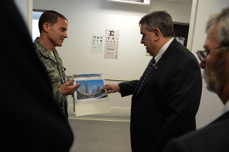 U.S. Air Force Staff Sgt. Brandon Broadbent, a 52nd Medical Operations Squadron ambulance services technician from Austin, Texas, talks with Brian Duffy, Veterans of Foreign Wars junior vice commander-in-chief, during a tour of the 52nd Medical Group at Spangdahlem Air Base, Germany, Aug. 7, 2014. Duffy visited the group to talk with Airmen about their role in serving the base. (U.S. Air Force photo by Airman 1st Class Kyle Gese/Released)