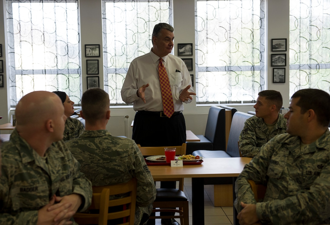 Robert Wallace, Veterans of Foreign Wars executive director, speaks to Airmen during lunch at Spangdahlem Air Base, Germany, Aug. 7, 2014. Wallace and Brian Duffy, VFW junior vice commander-in-chief, toured Spangdahlem as part of a VFW visit to learn about quality of life and other issues facing veterans today. (U.S. Air Force photo by Staff Sgt. Chad Warren/Released)