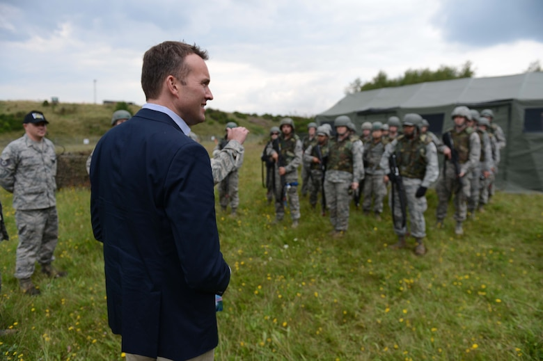 Under Secretary of the Air Force Eric Fanning speaks to Airmen assigned to the 606th Air Control Squadron during a base familiarization visit of Spangdahlem Air Base, Germany, Aug. 5, 2014. The 606th ACS demonstrated their combat readiness capabilities through a display of training operations. (U.S. Air Force photo by Senior Airman Gustavo/Released )