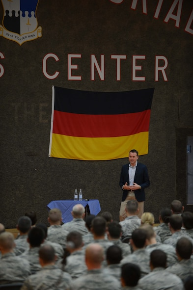 Under Secretary of the Air Force Eric Fanning speaks to the Airmen of Spangdahlem Air Base at the Skelton Memorial Fitness Center during a base familiarization visit Aug. 5, 2014. Fanning spoke to the wing about current topics in the Air Force and answered questions ranging from budget and readiness to promotion and force reduction. (U.S. Air Force photo by Senior Airman Gustavo Castillo/Released)