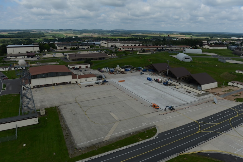 Construction continues on the flightline at Spangdahlem Air Base, Germany, Aug. 7, 2014. The construction will replace 90,400 square feet of concrete and cost approximately $2 million. (U.S. Air Force photo by Senior Airman Gustavo Castillo/Released)
