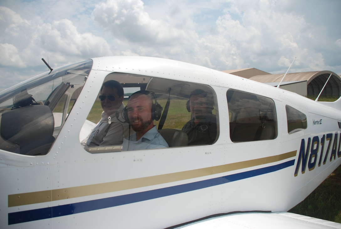 Brian Shreve, Rev-Up reporter, sits in a Piper Warrior III along with Lewayne Davis, Robins Aero Club chief flight instructor (left) and Paul Wenzel, Robins Public Affairs chief videographer (in the back seat), prior to take off. The Robins Aero Club was once limited to active duty personnel and Department of Defense civilians. On-base