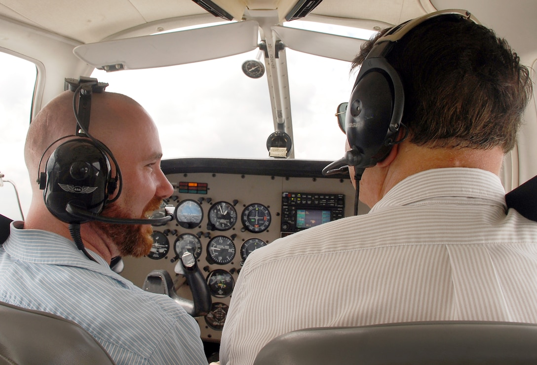 Brian Shreve, Rev-Up reporter (left), and Lewayne Davis, Robins Aero Club chief flight instructor, take one of the club's Piper Warrior III aircraft for a spin above Robins Air Force Base, Ga. The club was once limited to active duty personnel and Department of Defense civilians. On-base flying lessons are now available to all Middle Georgia residents following a recent partnership between the club and the local community. Base and local residents interested in signing up for flying lessons at the Robins Aero Club should call (478) 926-4867. (U.S. Air Force photo/Paul Wenzel)