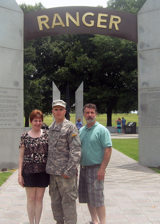 Senior Airman Brian Musum, 14th Air Support Operations Squadron tactical air control party member, stands with his parents, Margaret and Matthew Musum, after his graduation ceremony from Army Ranger School. (Courtesy photo)