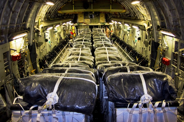 Straps secure water bundles aboard an Air Force C-17 Globemaster III before a humanitarian airdrop over Iraq, Aug. 8, 2014. The 816th Expeditionary Airlift Squadron aircrew airdropped 40 bundles of water for displaced citizens near Sinjar, Iraq. U.S. Air Force photo