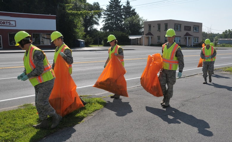 Airmen with the 109th Airlift Wing participated in the Adopt-A-Highway program in Schenectady, New York, on Aug. 10, 2014. The First Six Council planned the event to clean up the Wing's neighboring community and will be out four times a year. (U.S. Air National Guard photo by Tech. Sgt. Catharine Schmidt/Released)