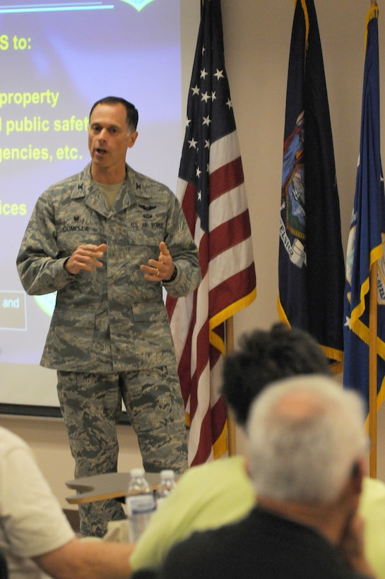 Col. Michael V. Comella, Commander of the 152nd Air Operations Group, gives a briefing to 152nd Air Operations Groups alumni members 9 Aug 2014. The briefing was part of an open house held by current members of the 152nd AOG. (New York Air National Guard Photo By Senior Airman Duane Morgan)