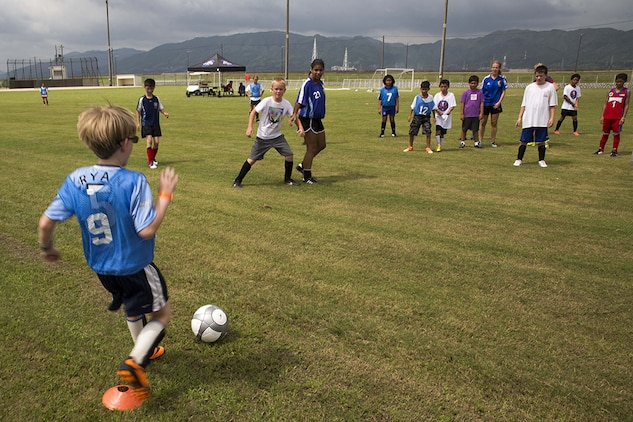 Participants of the Southern California Seahorse Soccer Club soccer camp take part in a scrimmage at Penny Lake fields aboard Marine Corps Air Station Iwakuni, July 24, 2014. The soccer camp was hosted by the Seahorses in association with Marine Corps Community Services to provide Iwakuni youth the opportunity to improve their soccer skills.