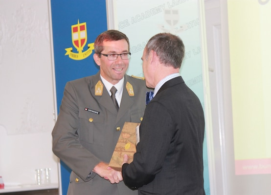 NDU Provost, Dr. John Yaeger, presents a gift to LtGen Erich Csitkovits, Commandant of the Austrian National Defence Academy.