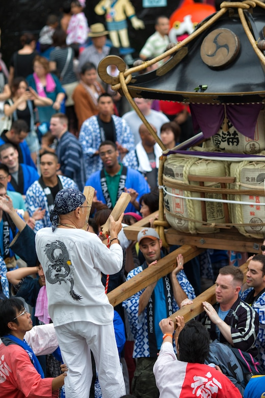 Japanese and American mikoshi shrine carriers chant and clap during the 64th annual Fussa Tanabata Festival, Fussa city, Japan, Aug. 8, 2014. The festival gives Yokota members an opportunity to meet and build friendships with the local community while experiencing Japanese culture. (U.S. Air Force photo by Osakabe Yasuo/Relased)