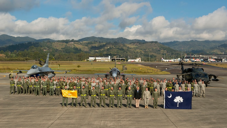 U.S. Airmen, assigned to the 169th Fighter Wing from McEntire Joint National Guard Base of the South Carolina Air National Guard, stand alongside Colombian Air Force Airmen during a group photo to kickoff a joint training event called Relampago (Lightning) 2014 in Rionegro, Colombia, Aug. 11, 2014. Relampago is a combined air cooperation engagement with the Republic of Colombia. One hundred Airmen and six F-16s from the 169th Fighter Wing will participate in the first major joint-air training opportunity under the auspices of the South Carolina National Guard's State Partnership Program with the country of Colombia. (U.S. Air National Guard photo by Tech. Sgt. Jorge Intriago/Released)