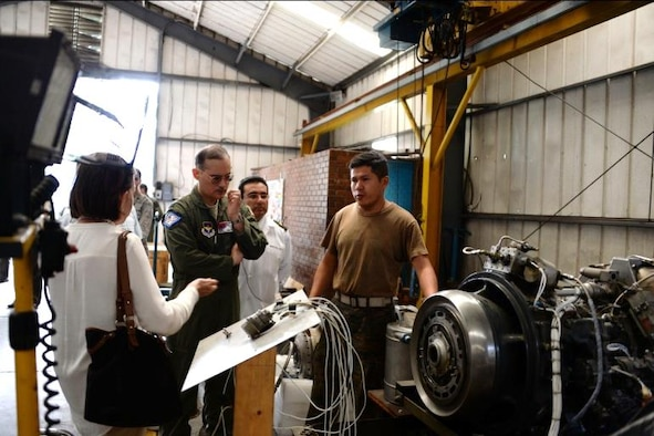 An airman from the Guatemalan air force gives a tour of the engine shop to participants on a medical subject matter expert exchange, while U.S. Air Force Lt. Col. Eric Burdge asks questions about occupational hazards in Guatemala City, Guatemala, Aug. 6, 2014.  Burdge is one of four U.S. Air Force National Guard members from the 189th Airlift Wing in Arkansas who are participating in the exchange, which is focused on public health, risk management and aerospace medicine.  (U.S. Air Force photo by Tech. Sgt. Heather R. Redman/Released)
