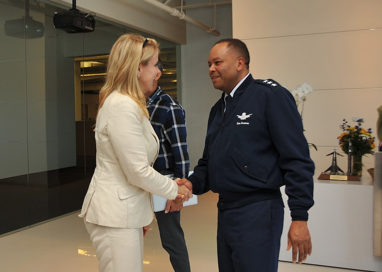 U. S. Air Force Lt. Gen. Sam Greaves, Space and Missile Systems Center commander, meets with Gwynne Shotwell, president of Space Exploration Technologies Corp., before a tour of SpaceX's Hawthorne, Calif., facility Aug. 7, 2014. (U.S. Air Force photo by Sarah Corrice)