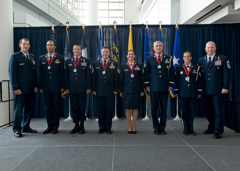 Lieutenant Gen. Stanley E. Clarke III, director of the Air National Guard (left) and Chief Master Sgt. James W. Hotaling, the command chief master sergeant of the ANG (far right), stand with the ANG Outstanding Airmen of the Year during an All Call event at Joint Base Andrews, Maryland August 7, 2014. The OAY winners are (left to right) Senior Airman Christian Goldsmith, Airman of the Year, Tech. Sgt. Doug Matthews, Non-Commissioned Officer of the Year, Master Sgt. Joseph G. Ashwood, Senior Non-Commissioned Officer of the Year, Master Sgt. Linda Schwartzlow, First Sergeant of the Year, Master Sgt. David Coker, Honor Guard Program Manager of the Year, and Tech. Sgt. Amy Ough, Honor Guard Member of the Year. (Air National Guard photo by Master. Sgt. Marvin R. Preston/Released)