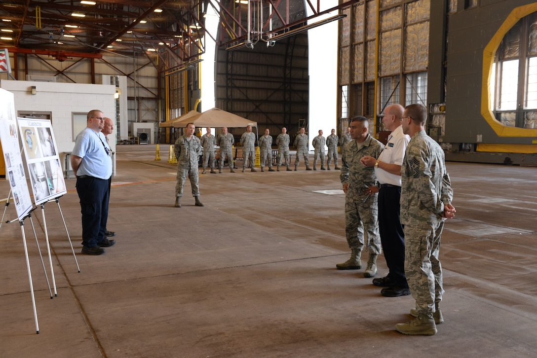 ALTUS AIR FORCE BASE, Okla. – Jim Kelly, 97th Air Maintenance Directorate director, explains recent maintenance process improvements his team has developed to U.S. Air Force Chief Master Sgt. Gerardo Tapia, command chief of Air Education and Training Command, during Tapia's visit to the 97th Air Mobility Wing Aug. 8, 2014. This was Tapia's first visit to Altus AFB since becoming the AETC command chief. (U.S. Air Force photo by Staff Sgt. Nathanael Callon/Released)