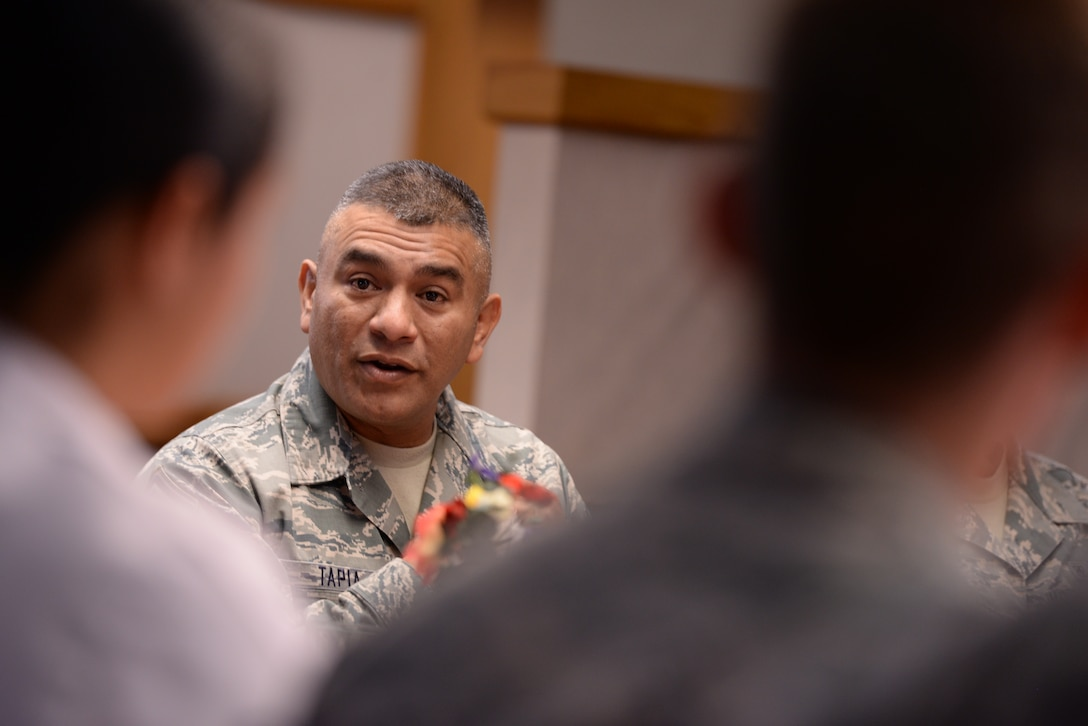 ALTUS AIR FORCE BASE, Okla. – U.S. Air Force Chief Master Sgt. Gerardo Tapia, command chief of Air Education and Training Command, speaks with Airmen from the 97th Air Mobility Wing during breakfast Aug. 8, 2014. Tapia met with Airmen and discussed current Air Force issues including force-shaping, the new enlisted performance system and developmental special duties. (U.S. Air Force photo by Staff Sgt. Nathanael Callon/Released)