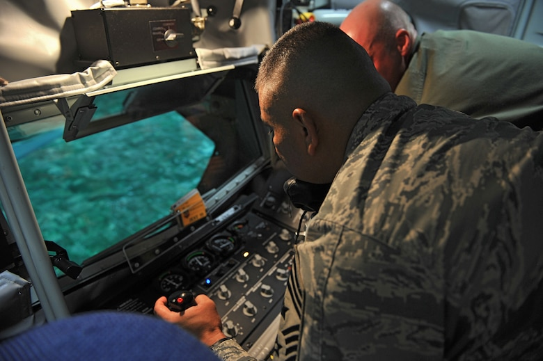 ALTUS AIR FORCE BASE, Okla. – U.S. Air Force Chief Master Sgt. Gerardo Tapia, command chief of Air Education and Training Command, simulates in-flight refueling from a KC-135 Stratotanker during a visit to the Boom Operator Weapons System Training Simulator Aug. 7, 2014. Tapia was able to get a hands-on look at the 97th Air Mobility Wing's training mission and its contribution to meeting future warfighter needs. (U.S. Air Force photo by Senior Airman Dillon Davis/Released)